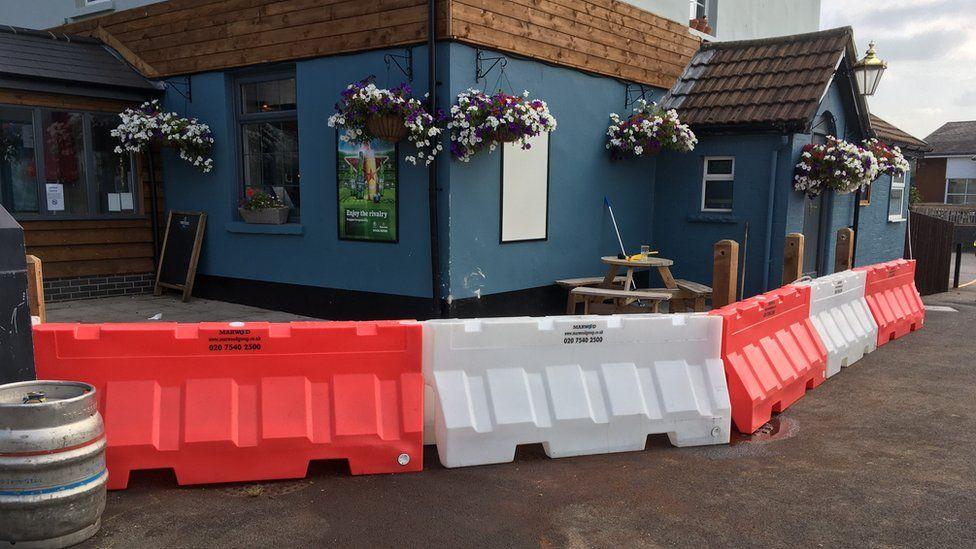 Barrier around the pub