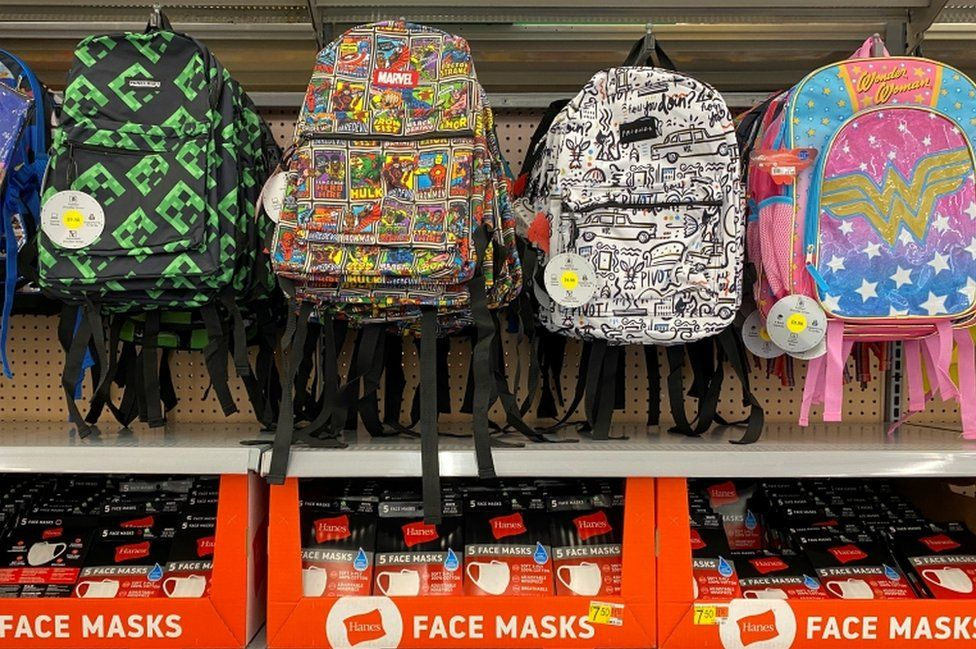 Face masks are shown for sale with back packs and back to school supplies at a Walmart store during the outbreak of the coronavirus disease in California