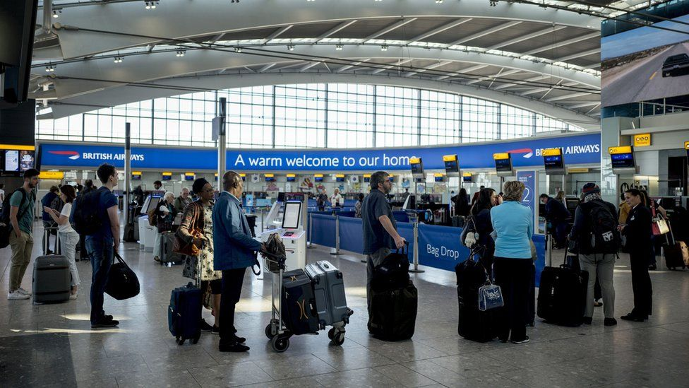 People queuing at Heathrow Airport