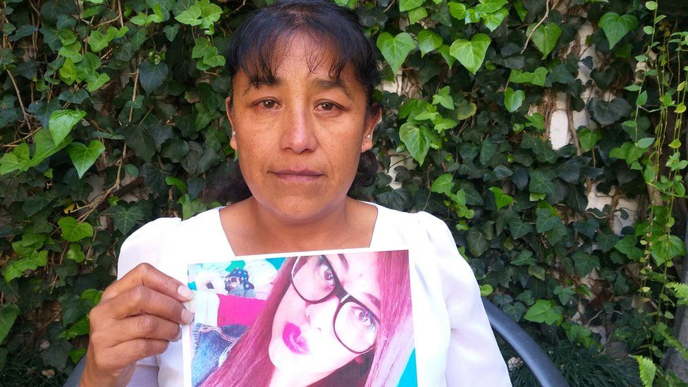 Araceli holding up a picture of her murdered daughter Abigail