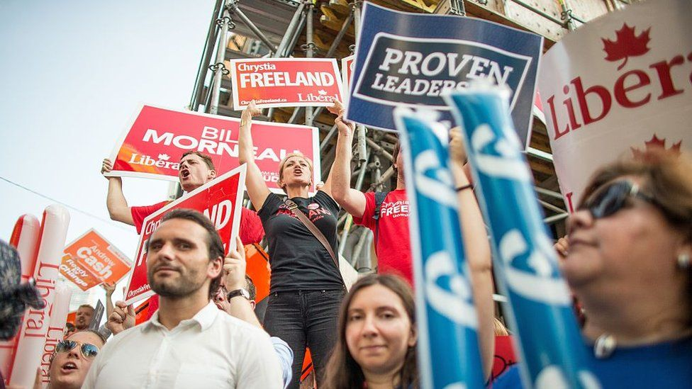 Canadian voters outside a debate before the 2015 federal election