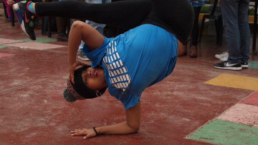 A street dancer performing during the first 'Llaqta funk' festival in Lima, Peru