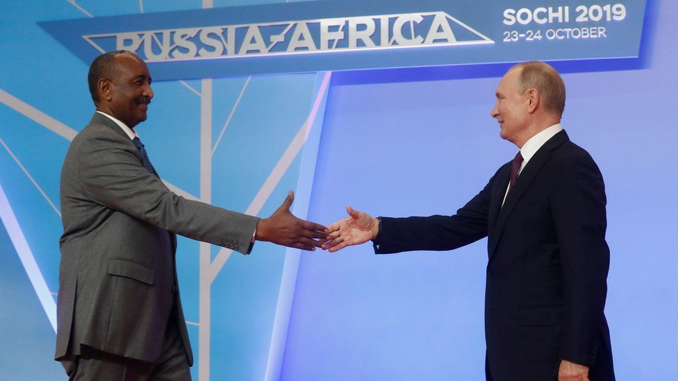 Russian President Vladimir Putin greets President of Sudanese Transitional Council General Abdel Fattah al-Burhan during the official welcoming ceremony for the heads of state and government of states participating in the 2019 Russia-Africa Summit in Sochi on October 23, 2019.
