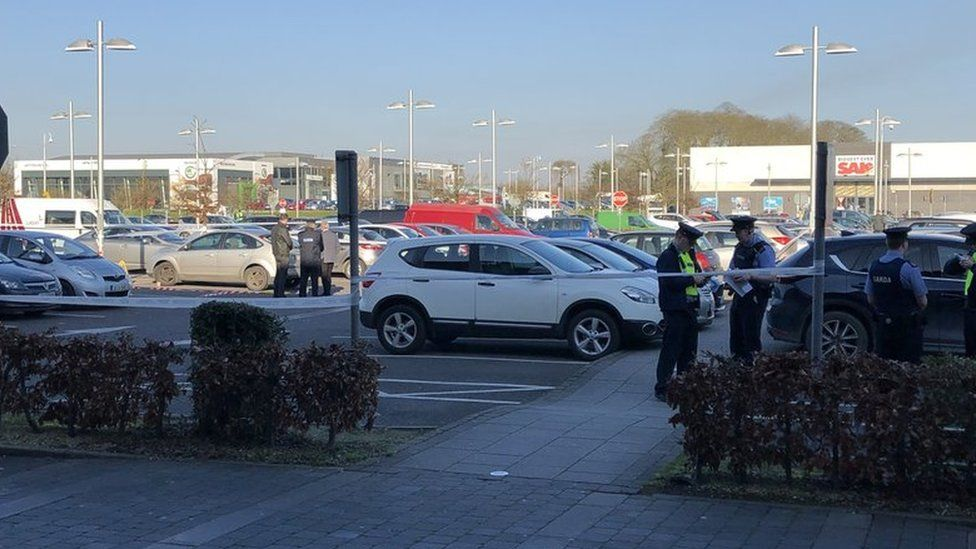Gardaí (Irish police) at the scene of the shooting at the M1 Retail Park in Drogheda
