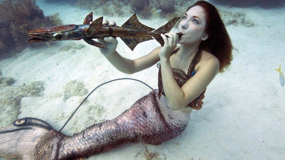 Mariah Reynolds, garbed as a mermaid