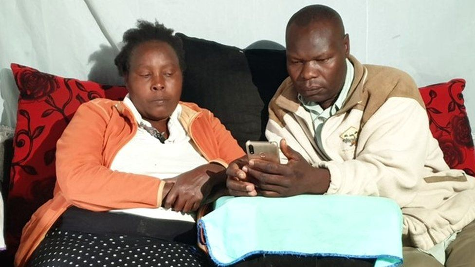 Agnes Wanjiru's sister and brother in law looking at a phone