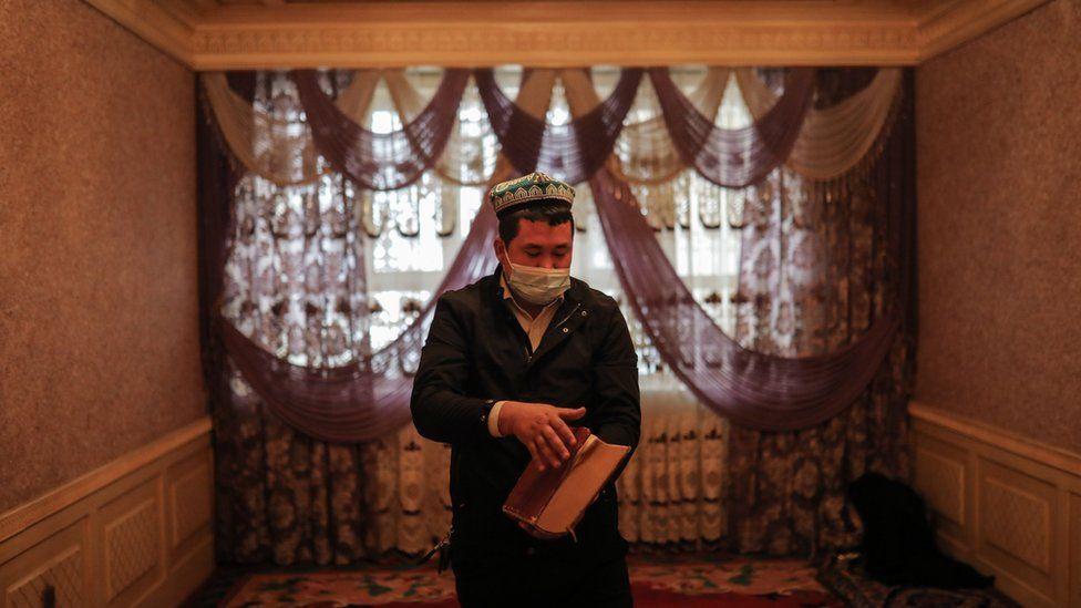 Muslim Uyghur man in a mosque, Xinjiang region (file pic)