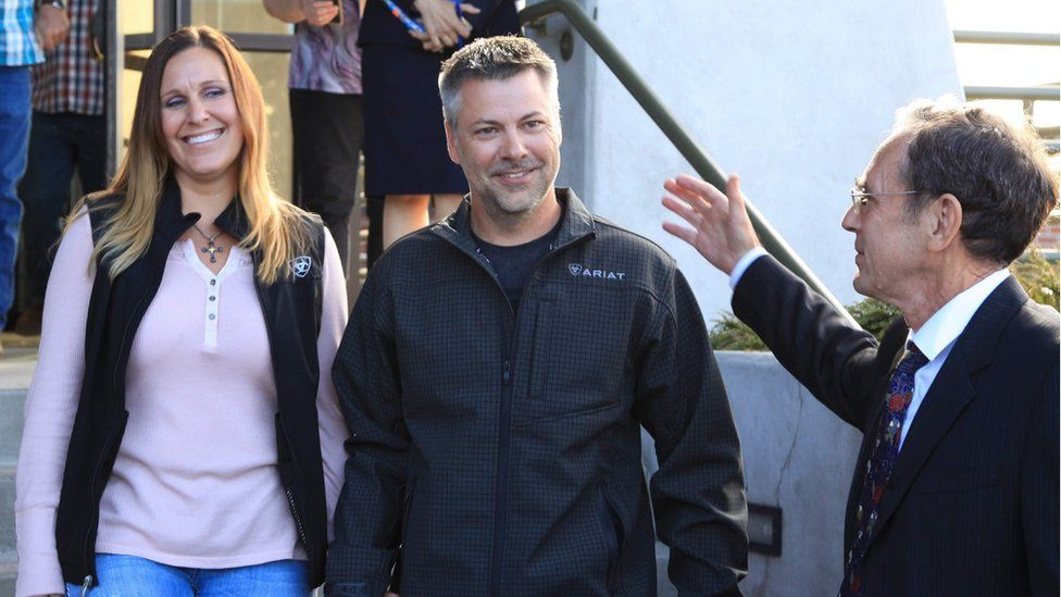 Josh and his wife Kelli walking out of the courthouse this morning, with Steve Wax