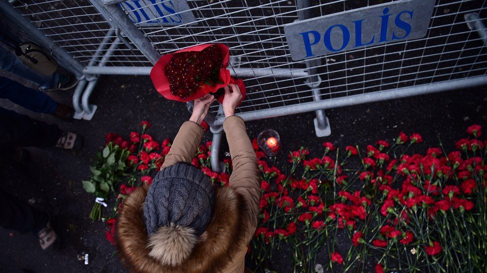 Flowers are laid outside the nightclub,