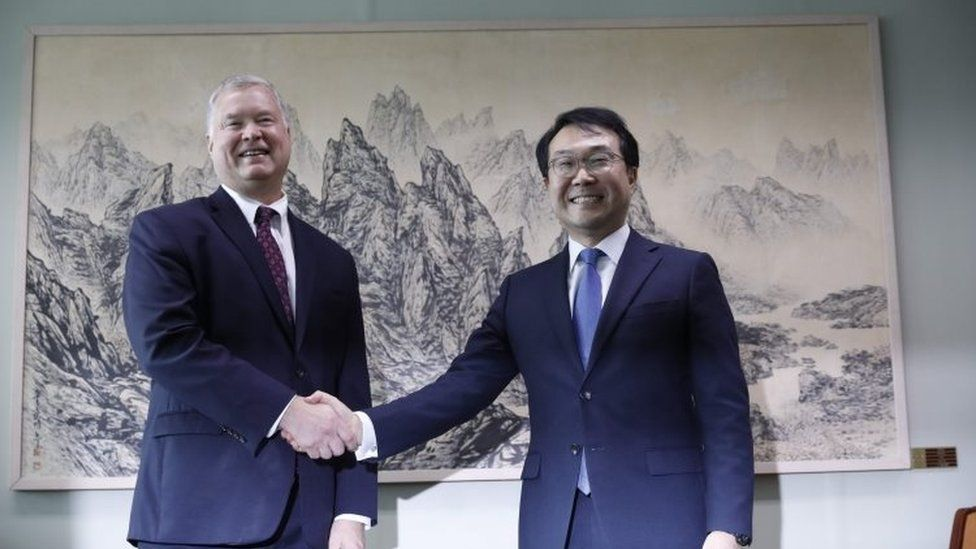 US special envoy for North Korea Stephen Biegun shakes hands with his South Korean counterpart Lee Do-hoo