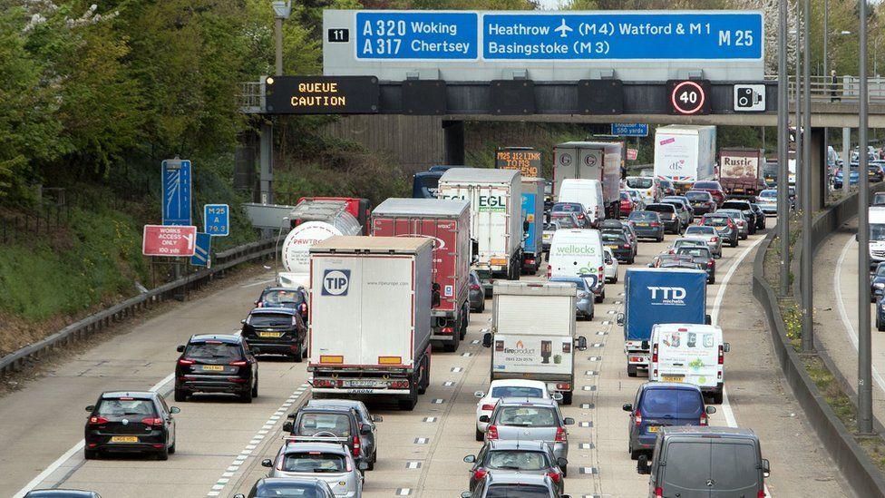 Slow-moving traffic on the M25 near Addlestone, Surrey