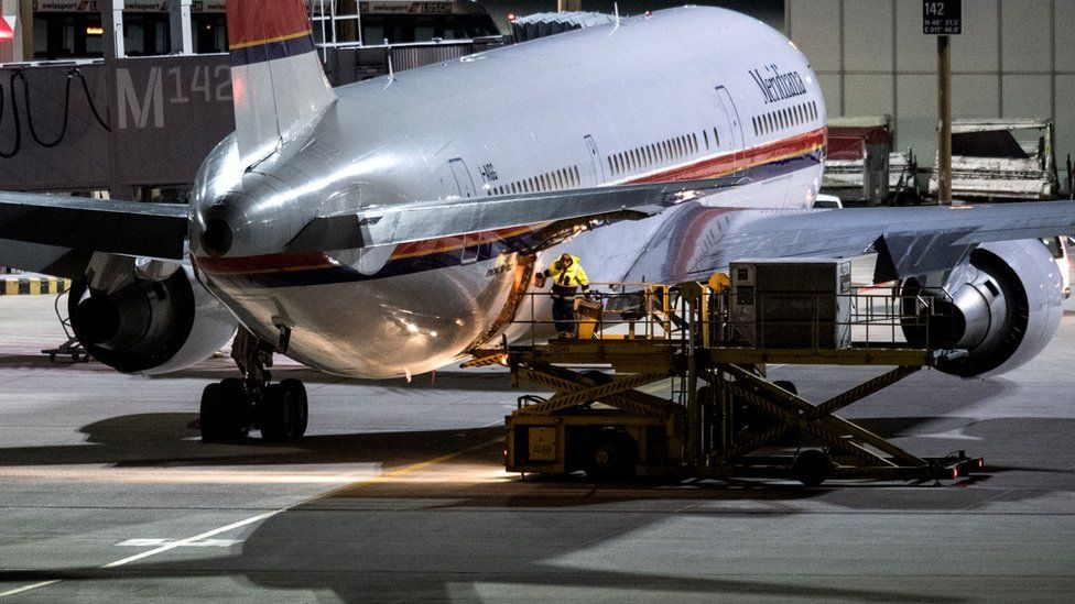 Plane on tarmac before deportation flight from Germany, file pic (Feb 2017)
