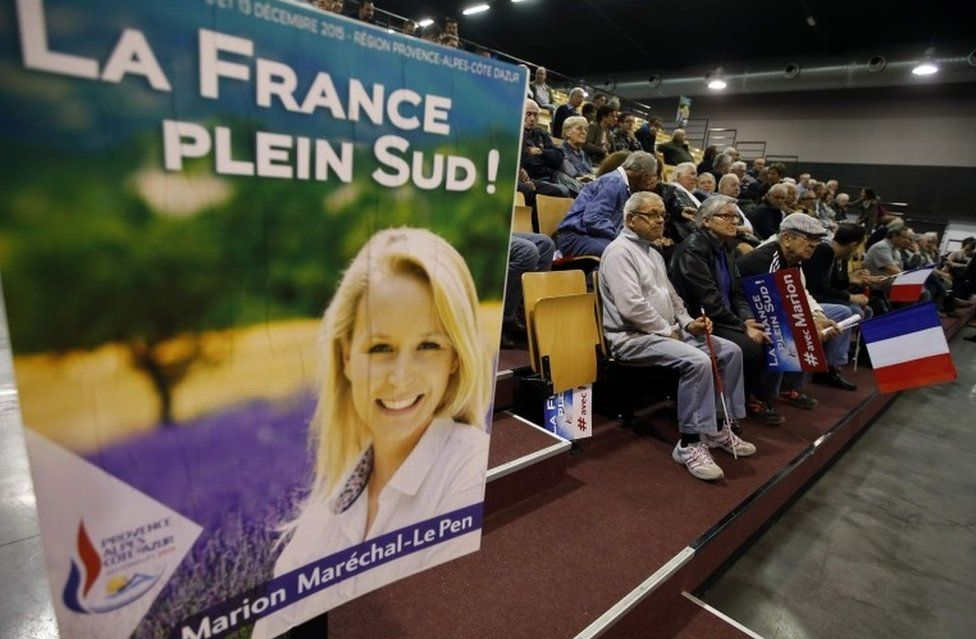 Supporters listen as Marion Marechal-Le Pen delivers a speech during a political rally for the upcoming regional election in Carpentras, France, 10 November 2015.