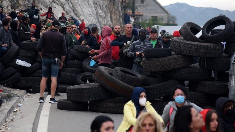 Protesters man tyres at a road block in Montenegro