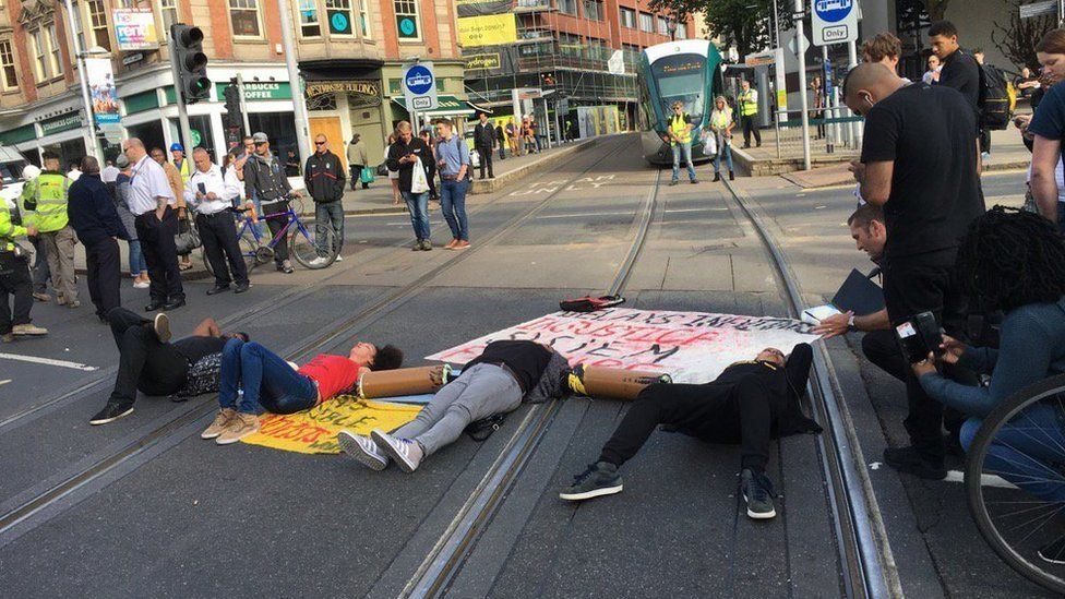Protestors lying down in the road