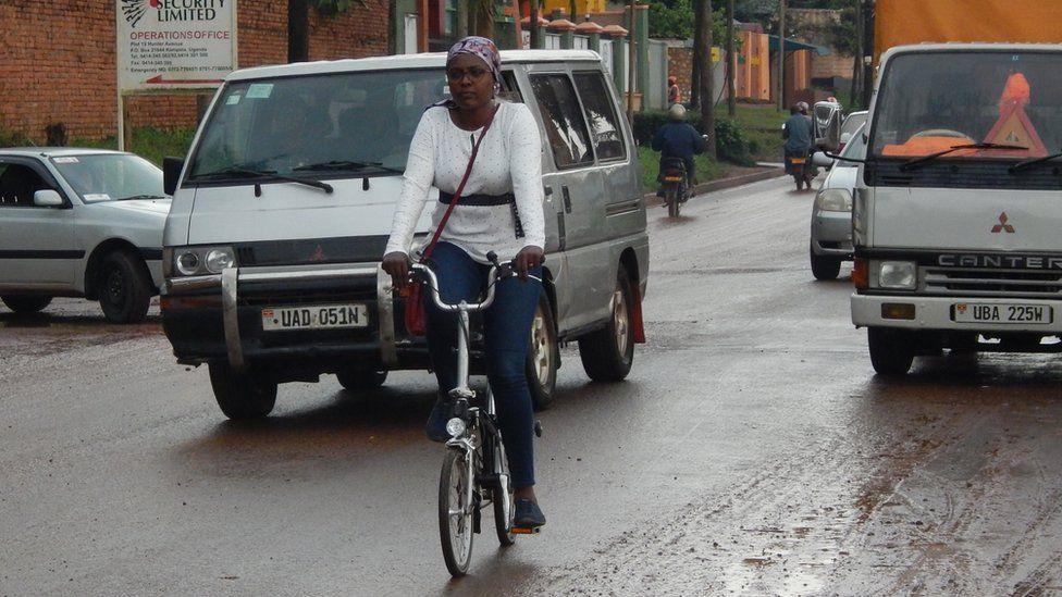 Amanda Ngabirano cycles in a busy street