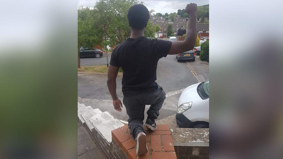 Rahman Telliam taking the knee