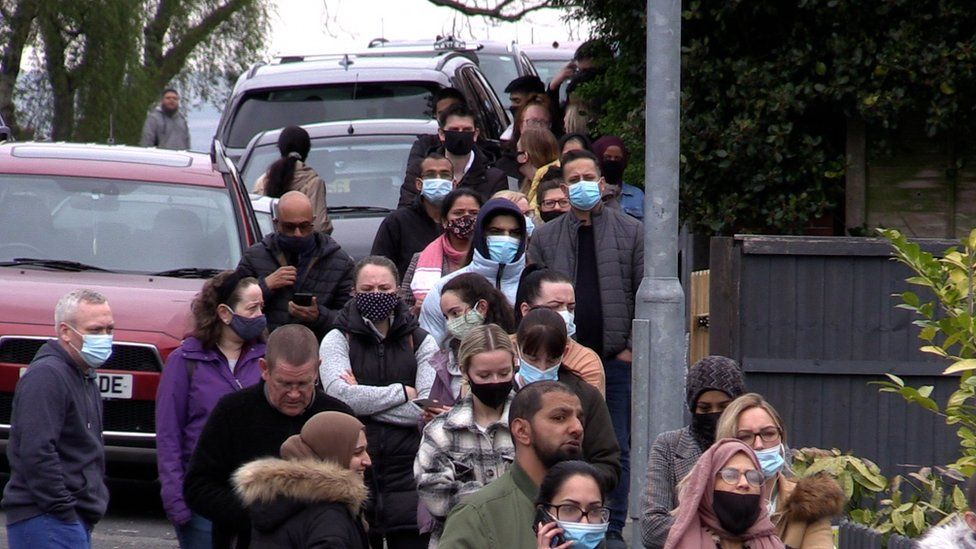 People queue at a vaccination centre in Bolton
