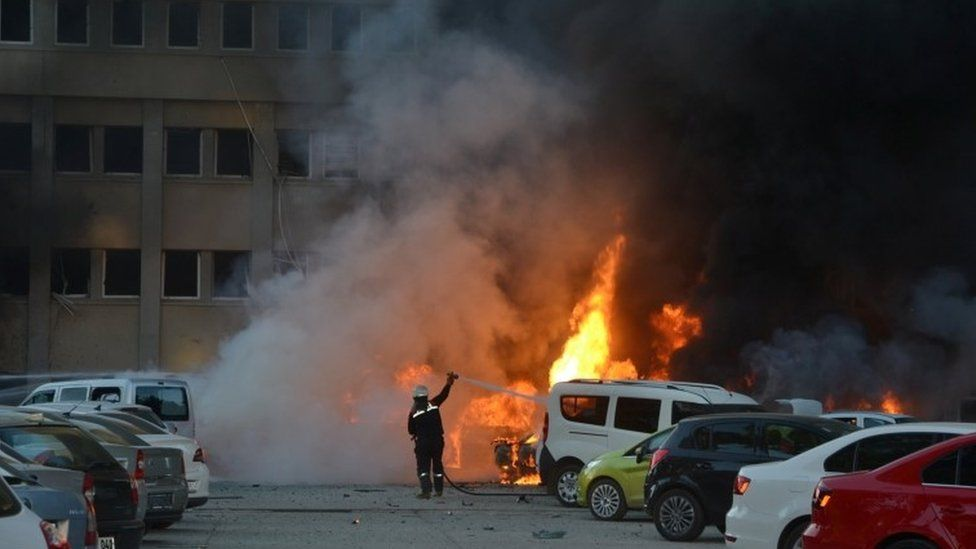 Cars burning outside governor's office, Adana