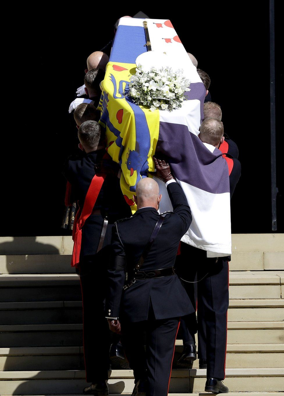 The Duke of Edinburgh's coffin, covered with His Royal Highness's Personal Standard is carried into St George's Chapel, Windsor Castle, Berkshire, during the funeral of the Duke of Edinburgh.