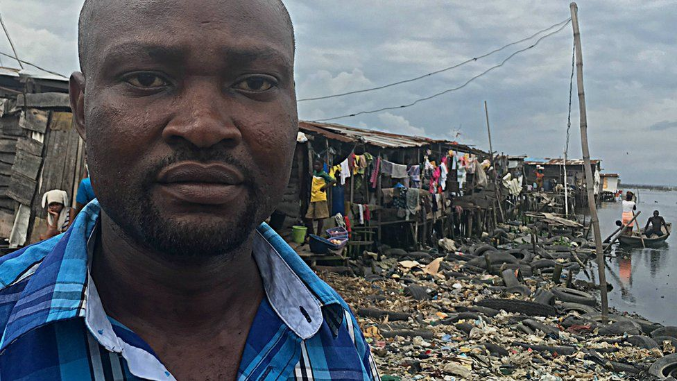 Seun pictured near his home in the slums of Lagos, Nigeria