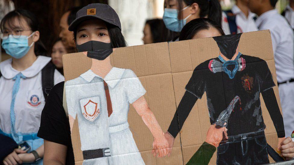 Students at Tsuen Wan Public Ho Chuen Yiu Memorial College show solidarity with the shot protester