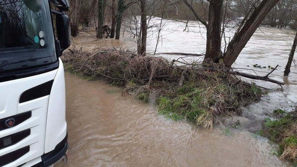 Lorry trapped in floodwater near Welshpool