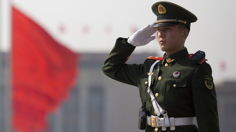 A Chinese paramilitary policeman salutes near the Great Hall of the People at the opening of the Chinese People's Political Consultative Conference (CPPCC) in Beijing, China, 3 March 2017