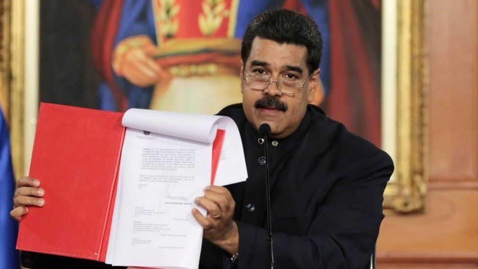 Venezuela's President Nicolas Maduro holds a document as he speaks during a ceremony at Miraflores Palace in Caracas, Venezuela May 1, 2017.