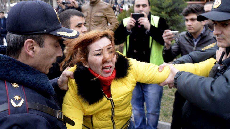 Police arrest a protester in Baku, 28 Feb 15