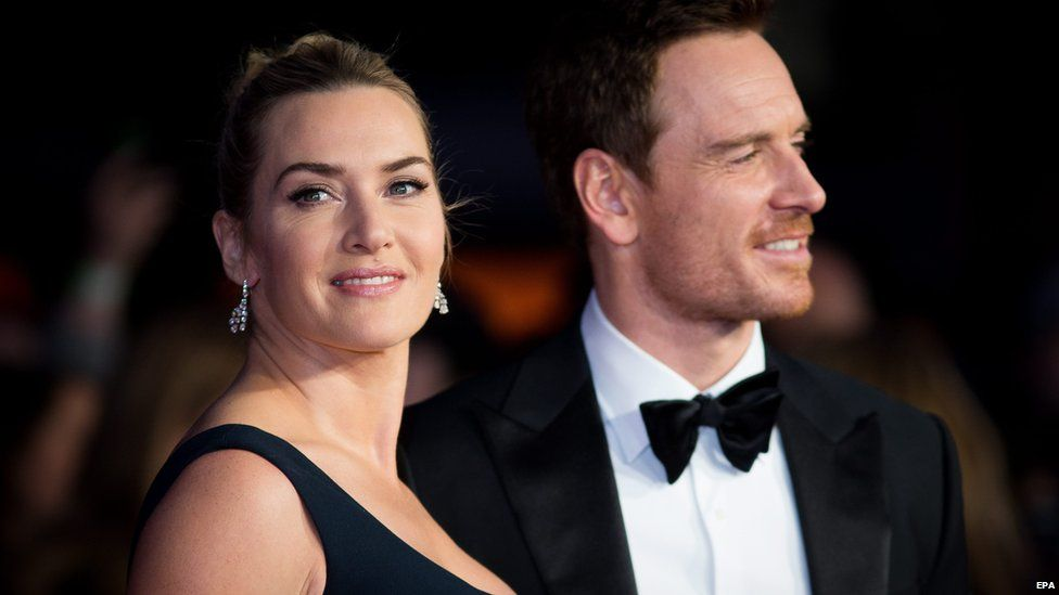 Kate Winslet stands with Michael Fassbender at the London Film Festival in October 2015