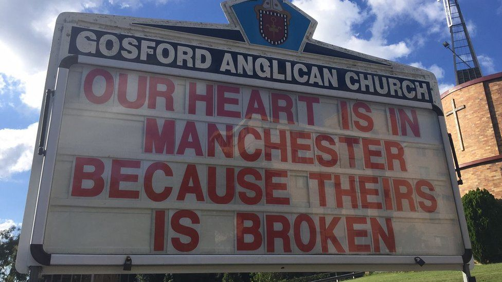 """Gosford Anglican Church billboard reads: """"Our heart is in Manchester because theirs is broken"""""""