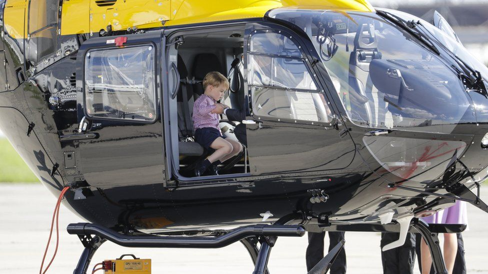 George sitting in a helicopter