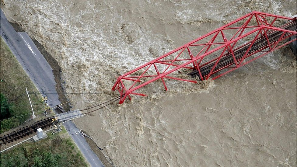 A collapsed railway bridge is seen over Chikuma river swollen by Typhoon Hagibis in Ueda, central Japan, October 13, 2019