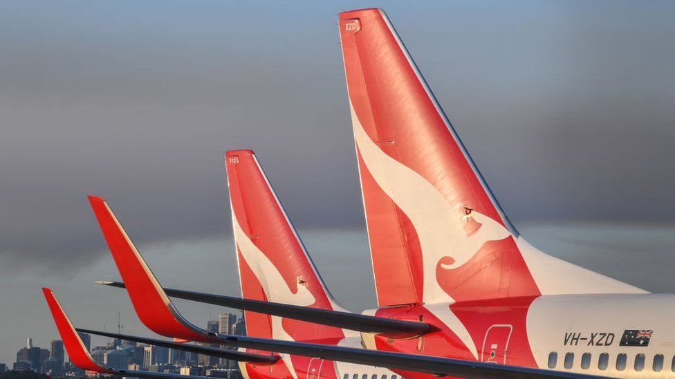 Two Qantas aircraft sit idle on the tarmac at Kingsford Smith Airport, Sydney.
