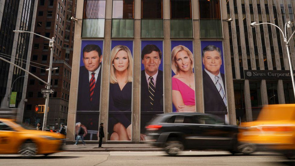 Posters of Fox News anchors outside the News Corporation offices in New York