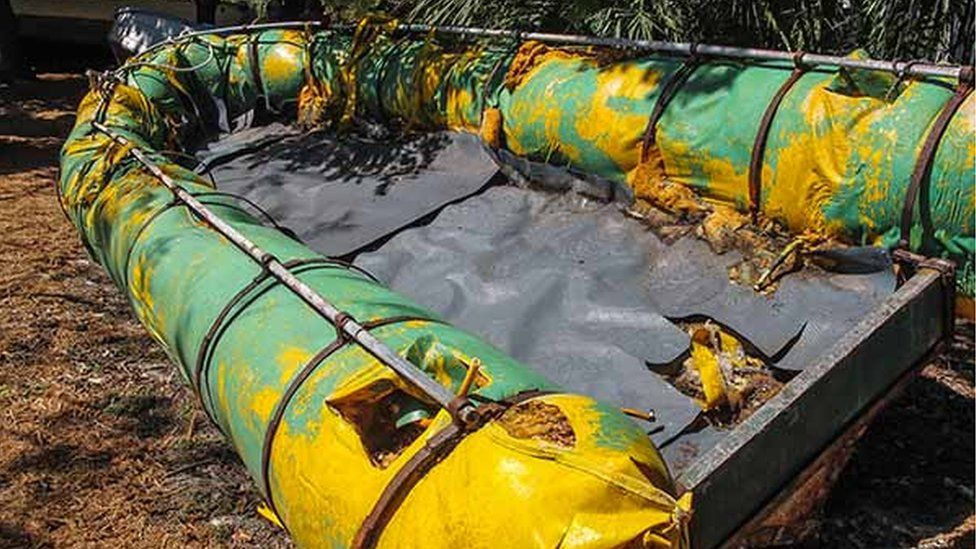 The same distinctive yellow tarpaulin can be seen on this chug that washed up on the Florida Keys