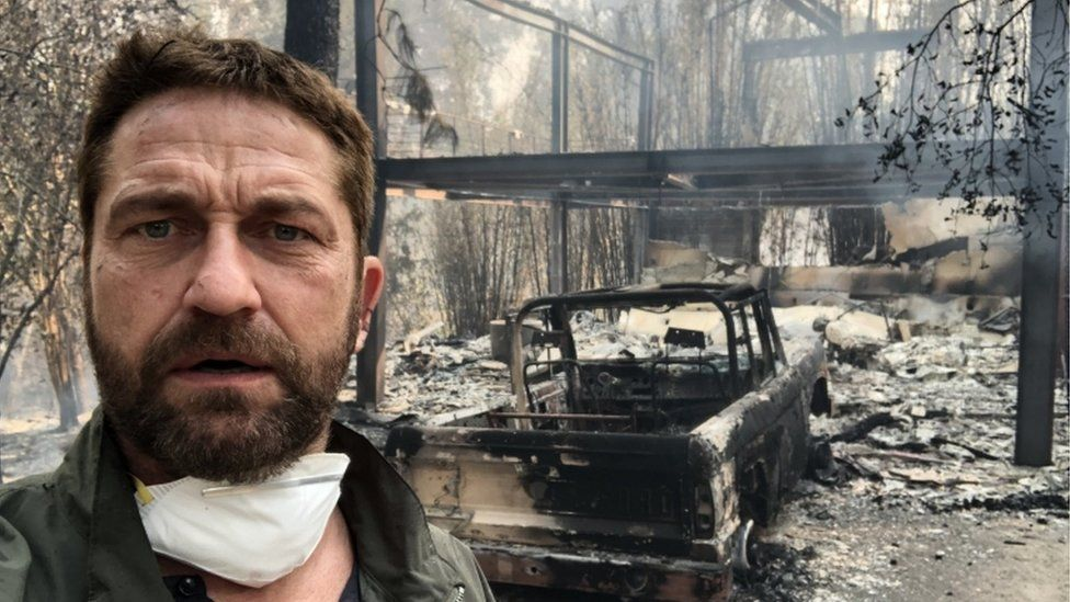 Gerard Butler in front of his fire-ravaged home