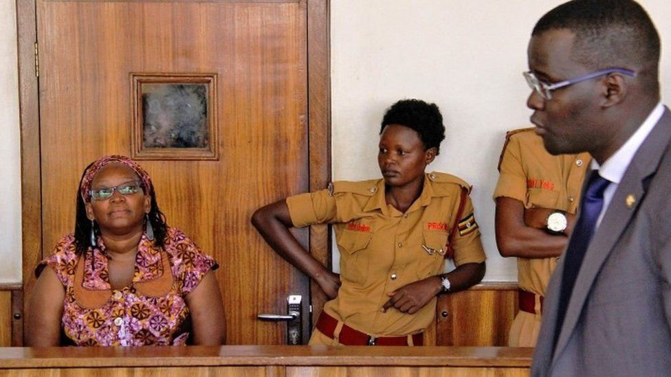 University lecturer and activist Doctor Stella Nyanzi (L) reacts in court as she attends a trial to face charges for cyber-harassment and offensives communication, in Kampala
