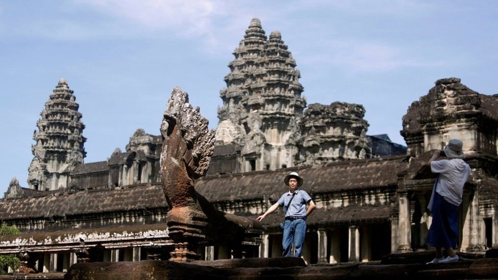 Tourists taking pictures at the Angkor Wat temple complex in Siem Reap province, Cambodia