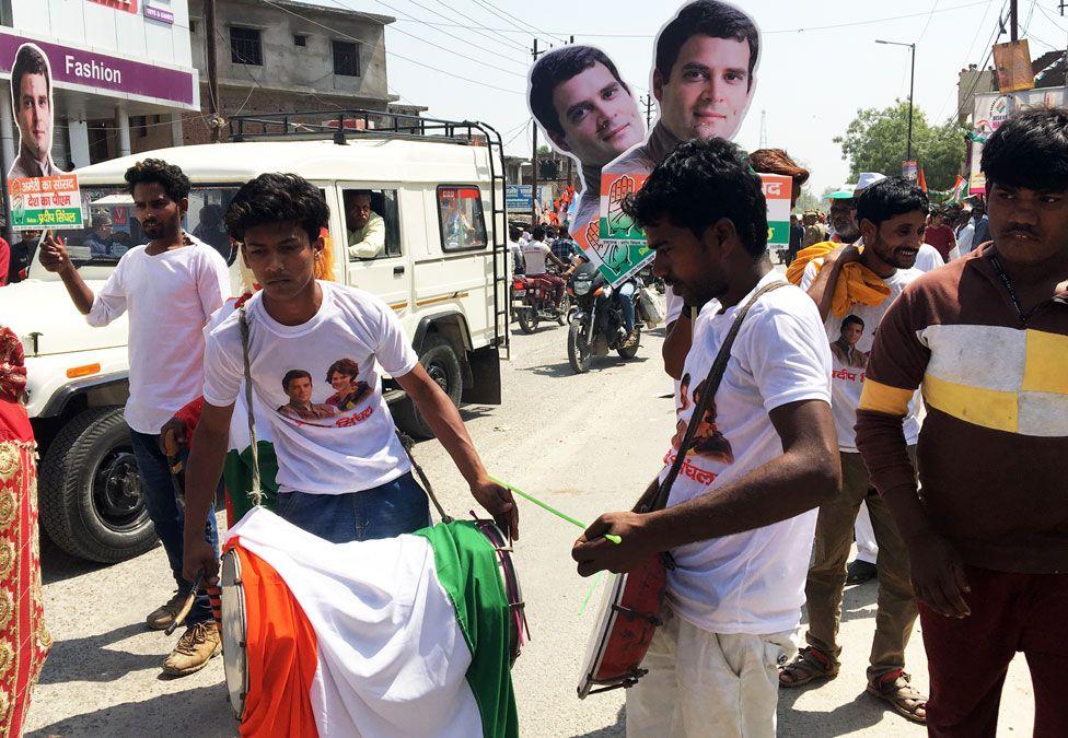 Men playing drums at Rahul Gandhi's roadshow in Amethi