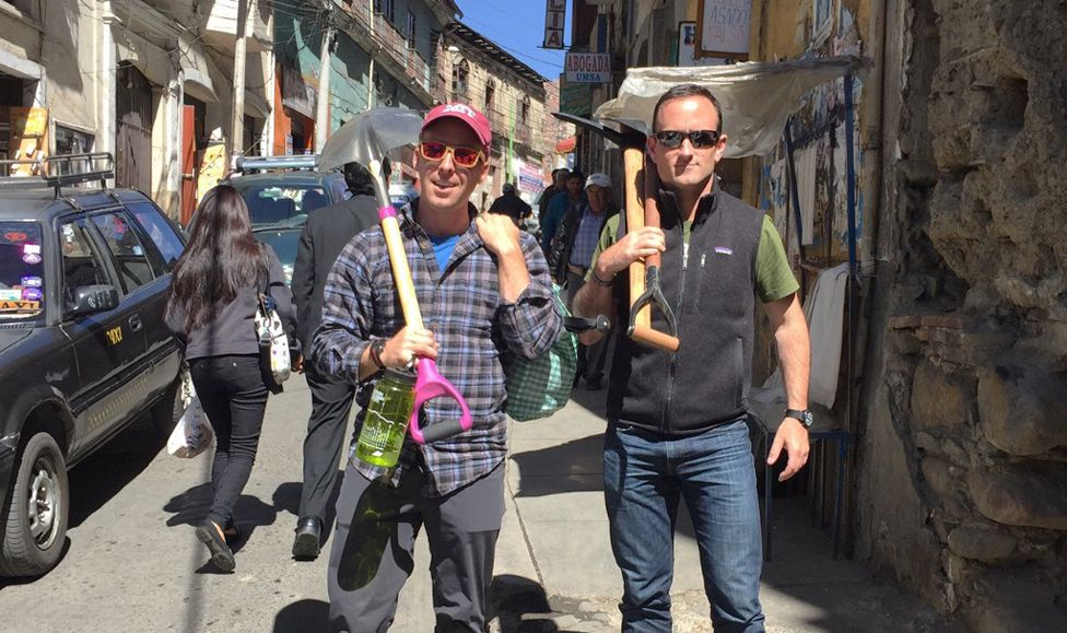 Dan holds a shovel and Isaac holds an ice axe in Laz Paz, Bolivia
