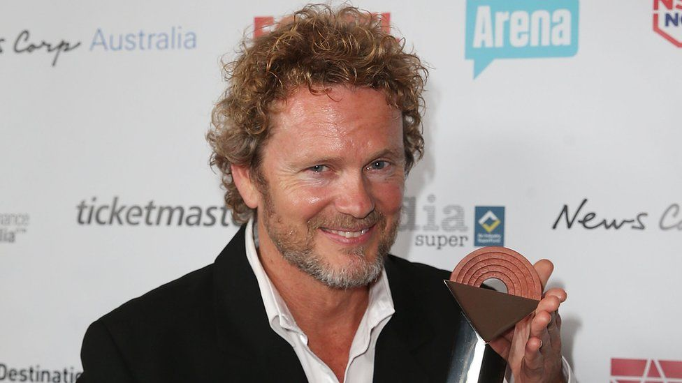 Craig McLachlan with an award in 2014