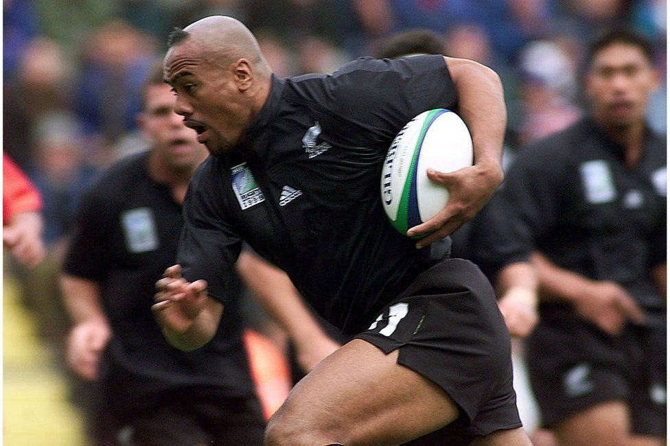 File picture of New Zealand's Jonah Lomu as he tucks the ball under his arm to run and score the All Blacks' first try against Tonga during their Rugby World Cup Group B match at Ashton Gate in Bristol, England, in this 3 October 1999 file photo