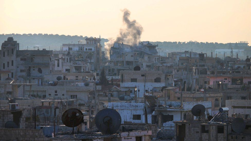 Smoke billows from building in rebel-held area of Deraa after reported shelling by Syrian government forces (22 January 2017)