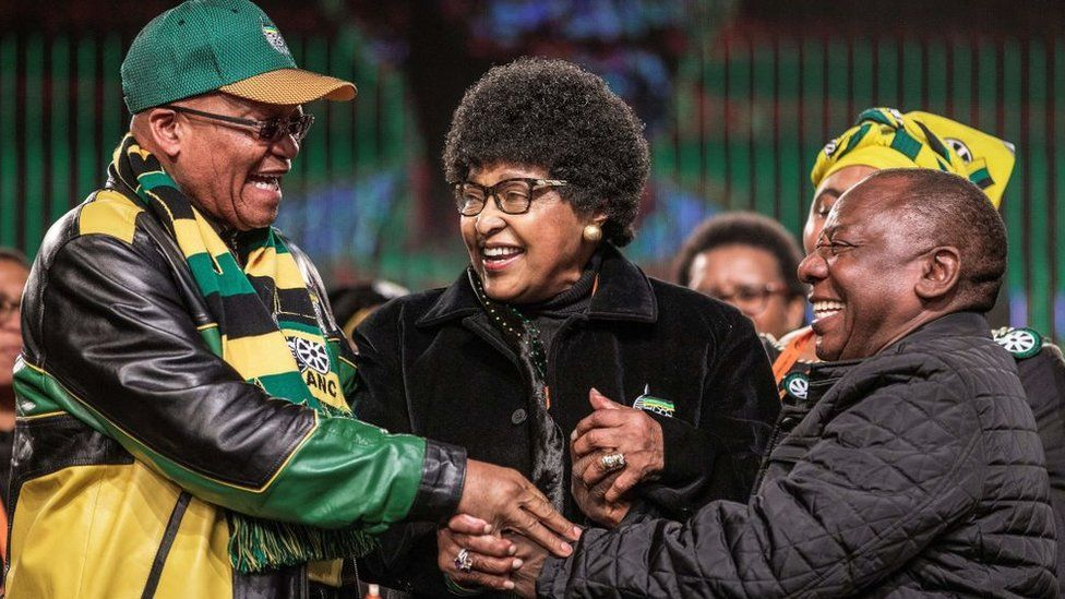 Former wife of the late South African President Nelson Mandela, Winnie Mandela (C) holds the hands of South African President Jacob Zuma (L) and South African Deputy President Cyril Ramaphosa (R) during the opening session of the South African ruling party African National Congress policy conference on June 30, 2017 in Johannesburg.