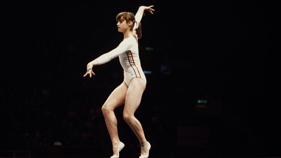 Nadia Comaneci of Romania performs her routine on the Balance Beam during the Women's Artistic Team all-around event on 19 July 1976 during the XXI Olympic Summer Games at the Montreal Forum, Montreal, Canada