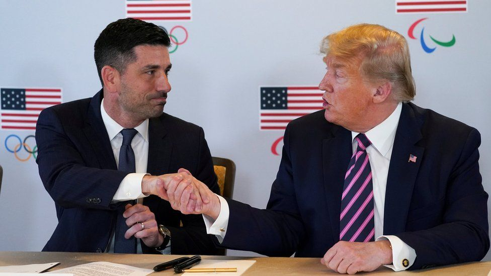 US President Donald Trump shakes hands with acting U.S. Department of Homeland Security Secretary Chad Wolf