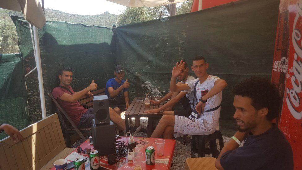 camp residents enjoy a beer together