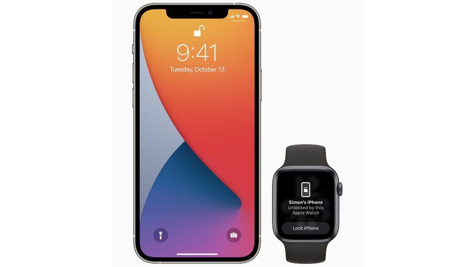 An iPhone next to an Apple Watch